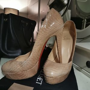 Authentic Louboutin Snake skin pumps